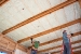 Photo of spray foam insulation installed in the ceiling