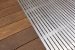 Photo of decking and aluminum entry grate