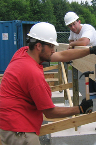 Photo of past team member Mike Boteler setting framing
