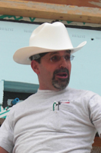 Photo of team electrical mentor John Cartagirone wearing a cowboy construction hat.