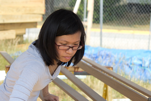 Photo of team leader Lynn Khuu working on site