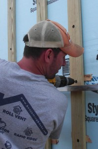 Photo of construction mentor John Morris using a drill