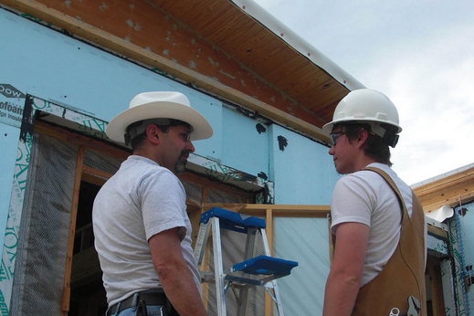 Photo of electrical mentor and team leader talking on the construction site
