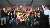University of Maryland celebrates after winning the U.S. Department of Energy Solar Decathlon 2011Credit: Stefano Paltera/U.S. Department of Energy Solar Decathlon)